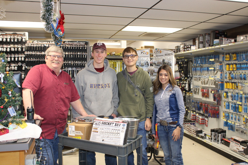 Students with a Ag Producer Employee receiving donation of tools for the Ag Shop