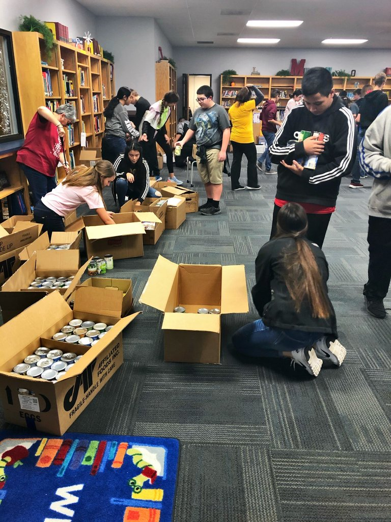 Sorting donated foods into boxes