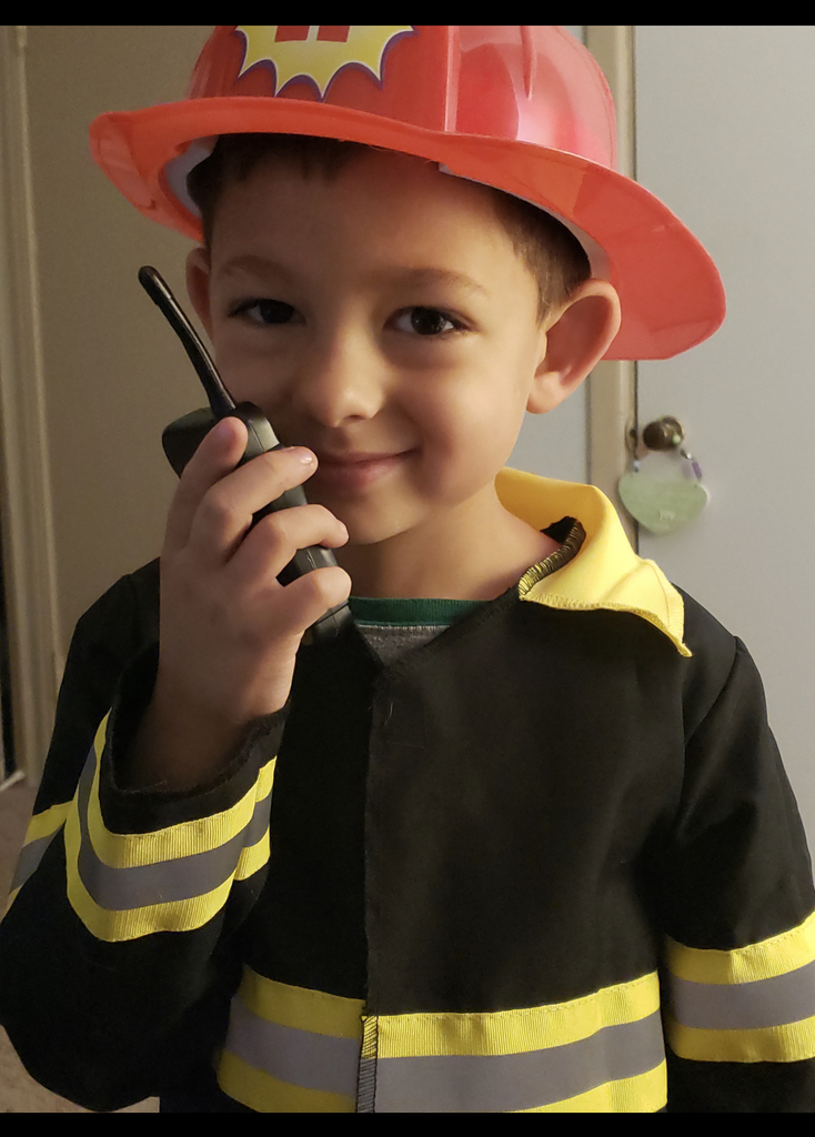 Student dressed as a firefighter for career day