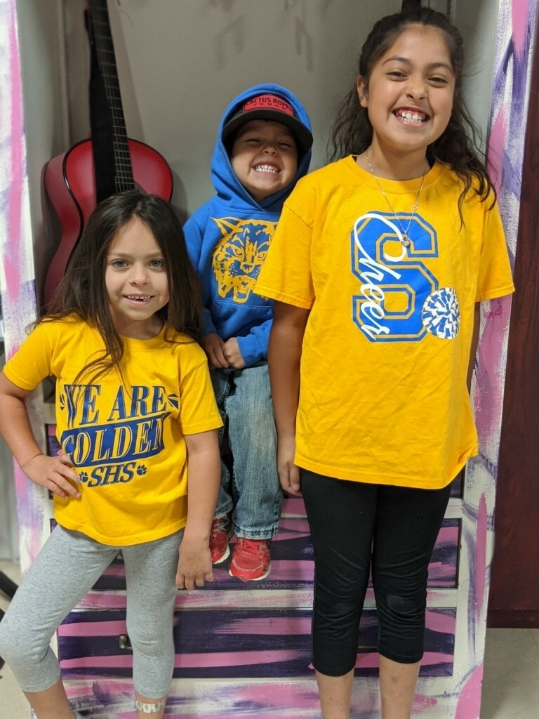 Students dressed in blue and gold for spirit week